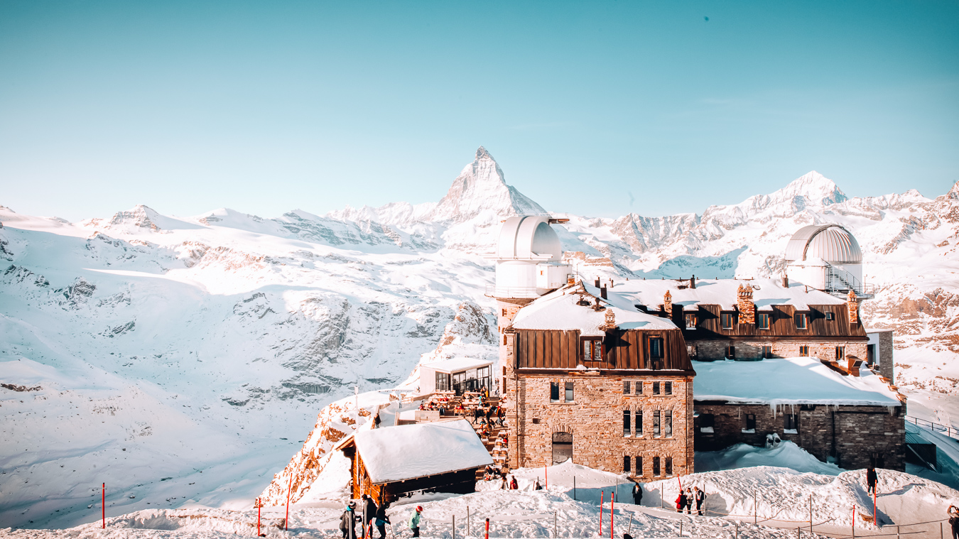 A large building and people in Zermatt