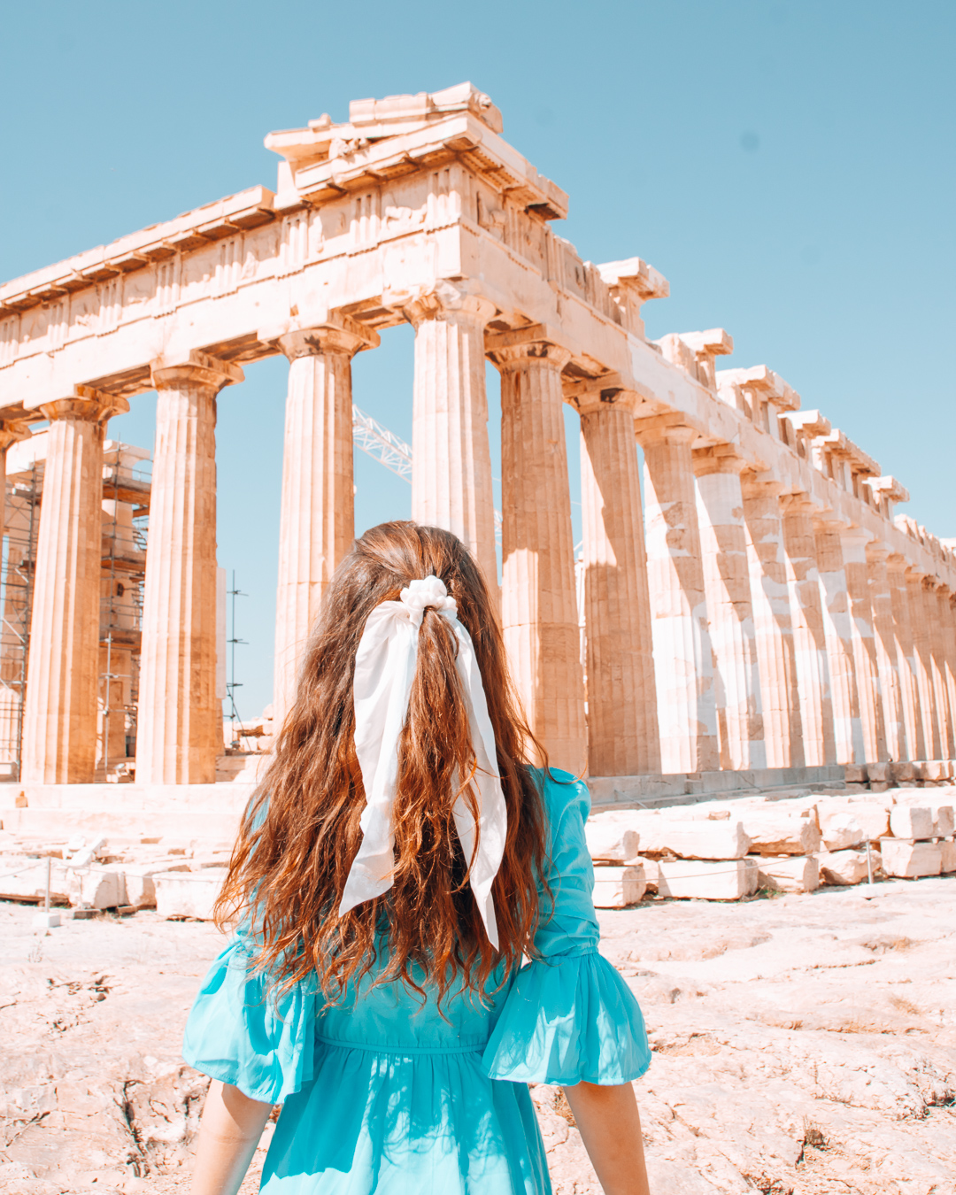 Girl looking at the Acropolis