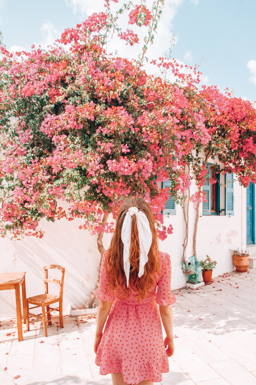 Girl in front of a building with flowers in Lefkes