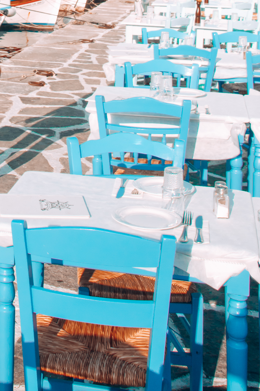 Seats and tables at a restaurant in Naoussa, Paros