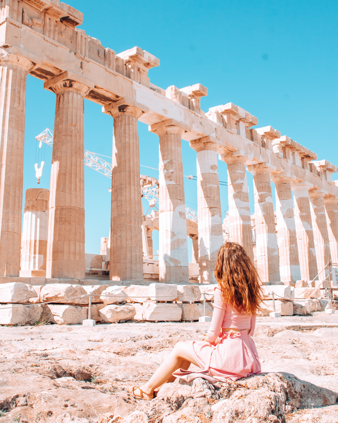 Girl sitting at the Acropolis