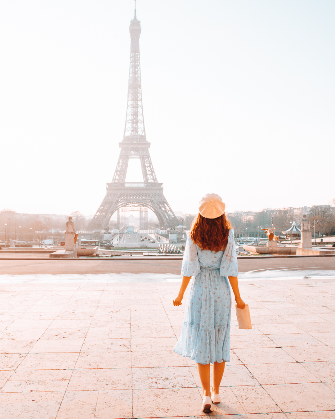 Girl looking at the Eiffel Tower in Paris