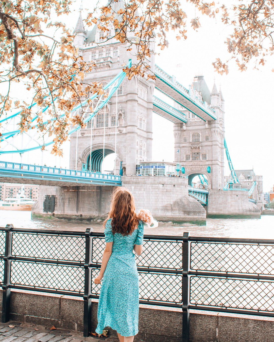 Girl with flowers at the Tower Bridge in London