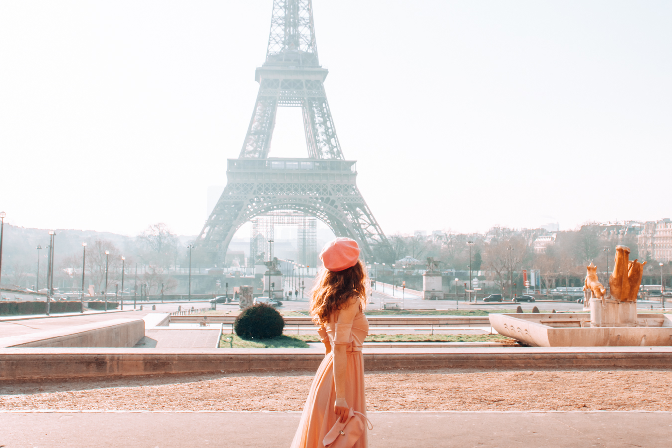 Girl in front of the Eiffel Tower