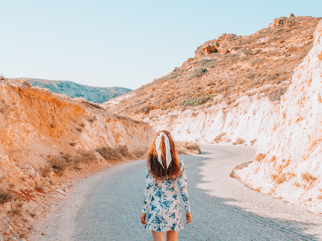 Girl walking on a road