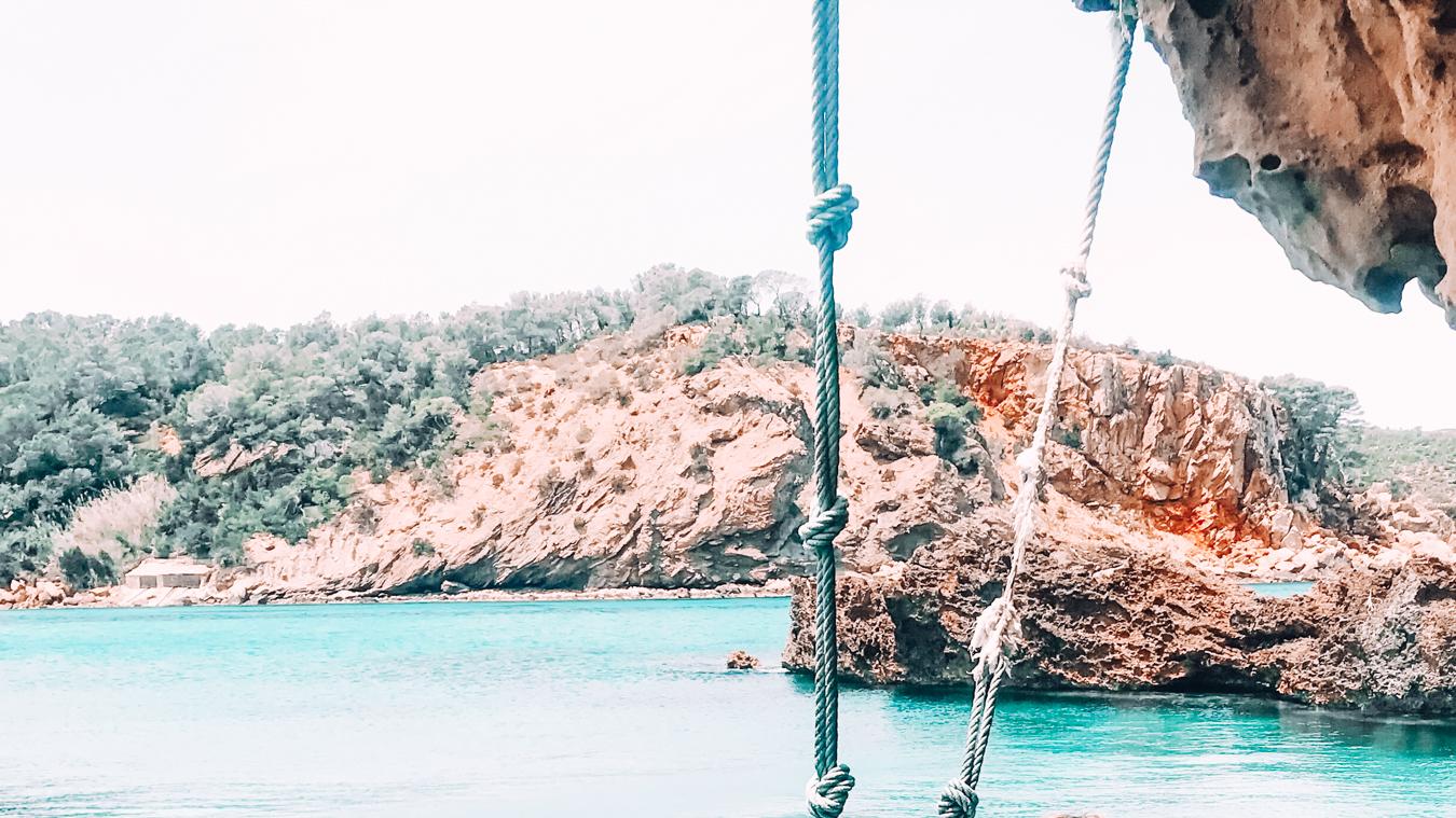 Instagrammable Playa Cala Xarraca swing in Ibiza