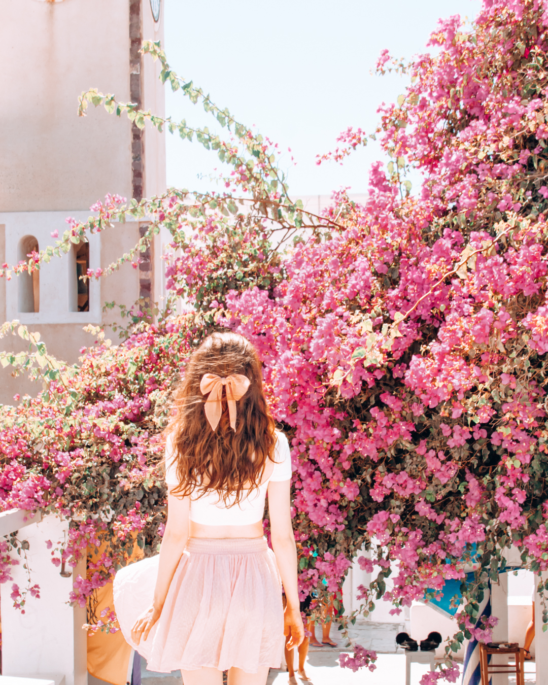 Girl looking at pink flowers
