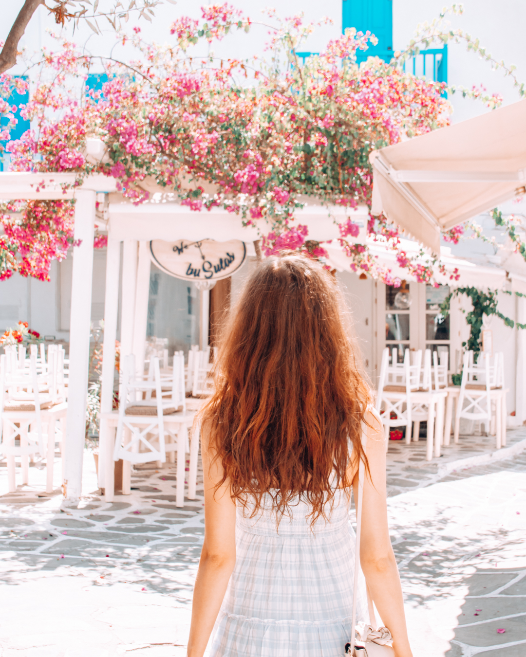 Girl in front of a restaurant with flowers