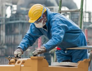 A man working with his protective gear