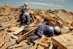 Rescuers searching for survivors in rubble