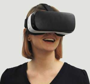A woman looking through VR goggles
