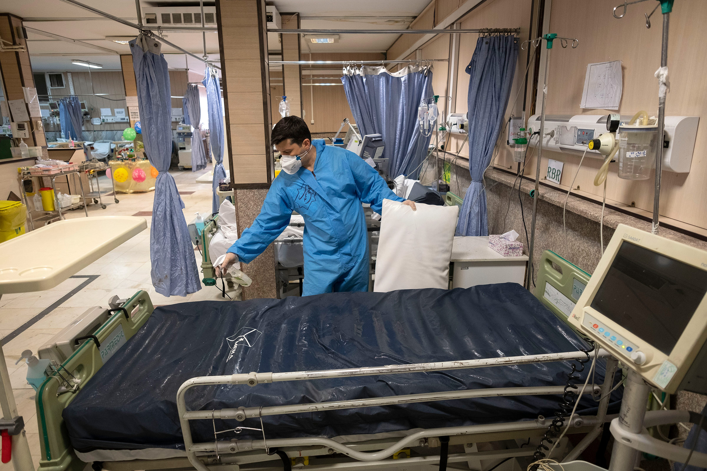 A health assistant disinfects a bed in Firoozabadi hospital's Covid-19 ward in Tehran, Iran, on March 20.