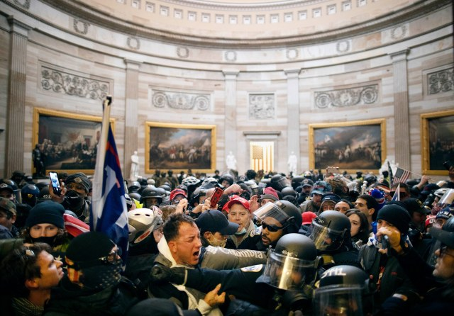 Police clash with rioters who breached security and entered the Capitol building in Washington DC, on January 6.