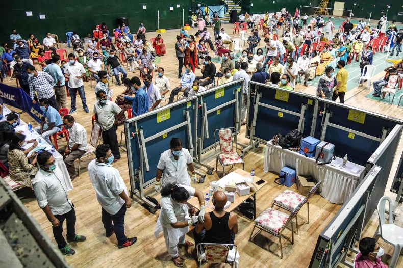 Vaccinations are carried out at an indoor stadium in Guwahati, India, on April 22.