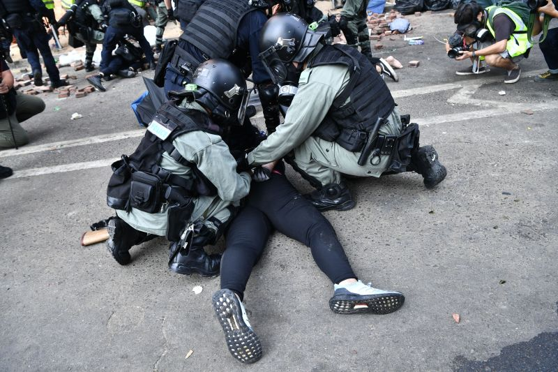 Police tackle protesters near the Hong Kong Polytechnic University on November 18, 2019.