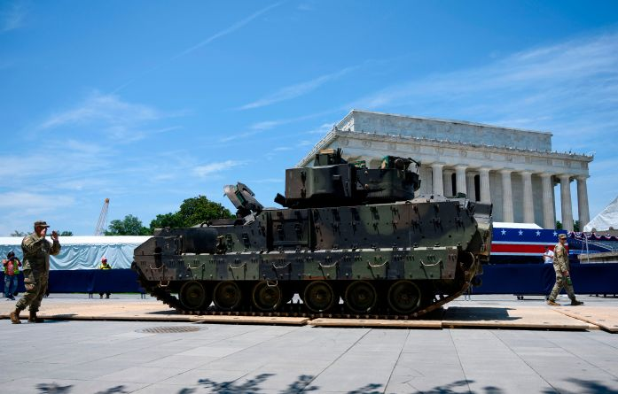 "Members of the US military guide a Bradley Fighting Vehicle on July 3, 2019 as preparations are made for the ""Salute to America"" event at the Lincoln Memorial on the National Mall in Washington, DC."