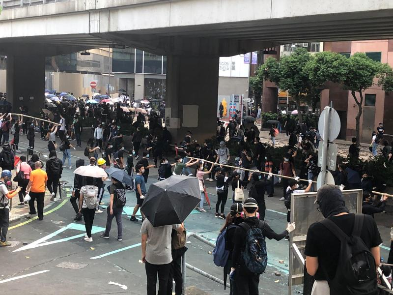 Protesters form a human chain to pass along supplies in Kowloon, Hong Kong, on November 18, 2019.