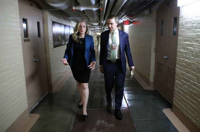 Rep. Abigail Spanberger (D-VA) walks with her press secretary to a House Democratic caucus meeting at the U.S. Capitol Tuesday where formal impeachment proceedings against President Trump were announced by Speaker of the House Nancy Pelosi