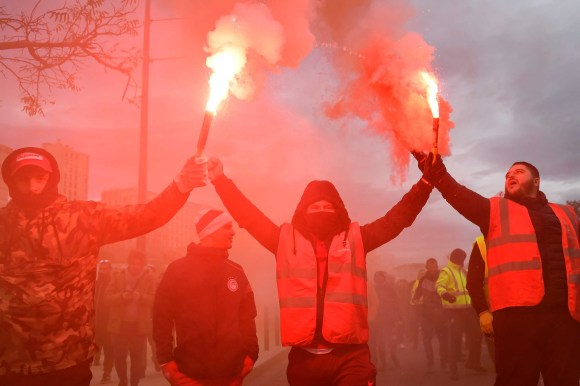 Also in Marseille, dockers march with smoke bombs in hand. Photo: Clement Mahoudeau/AFP via Getty Images