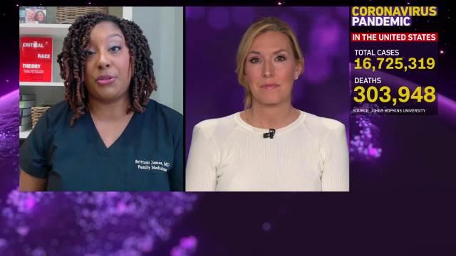 Dr. Brittani James, left, speaks during an interview on December 16.