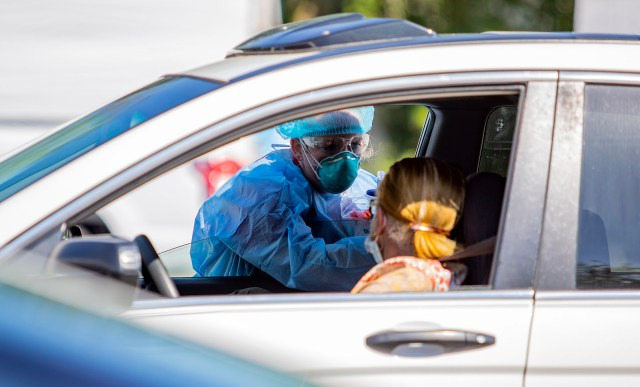 Tidelands Health medical professionals conduct a drive-through Covid-19 testing site on Friday July 17, at Myrtle Beach Pelicans Ballpark in Myrtle Beach, South Carolina.