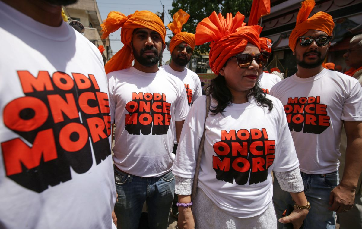 Supporters of the Bharatiya Janata Party (BJP) wear T-shirts supporting Indian Prime Minister Narendra Modi in Bhopal on April 23, 2019.