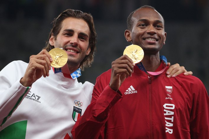 Joint gold medalists Gianmarco Tamberi of Italy and Mutaz Essa Barshim of Qatar celebrate on the podium together on August 2.