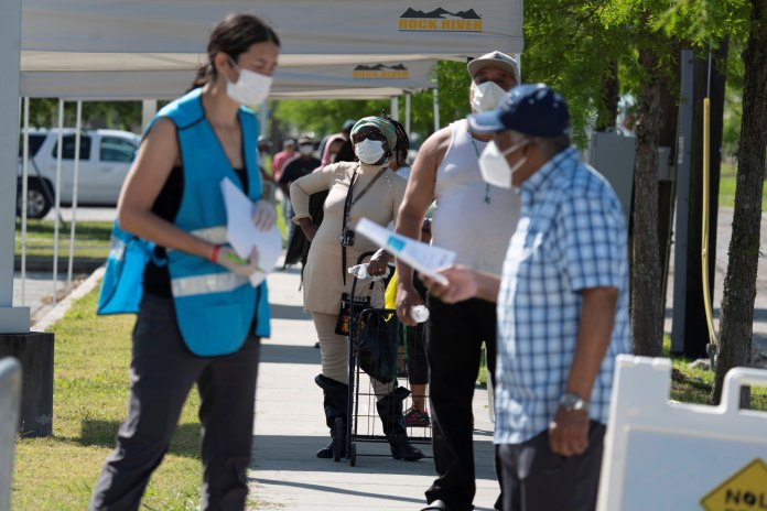People line up for a coronavirus disease screening test at Xavier University of Louisiana in New Orleans, April 21.