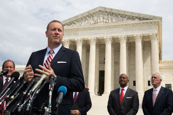In this September 9, 2019 archive photo, Missouri Attorney General Eric Schmitt speaks before the United States Supreme Court in Washington.