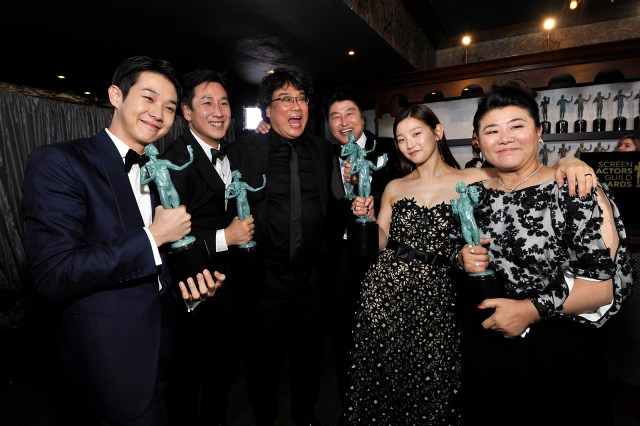 Choi Woo-shik,Lee Sun Gyun, Bong Joon-ho, Song Kang Ho, Park So-dam, and Jeong-eun Lee winners of Outstanding Performance by a Cast in a Motion Picture for 'Parasite', pose in the trophy room during the 26th Annual Screen Actors Guild Awards at The Shrine Auditorium on January 19, 2020 in Los Angeles.