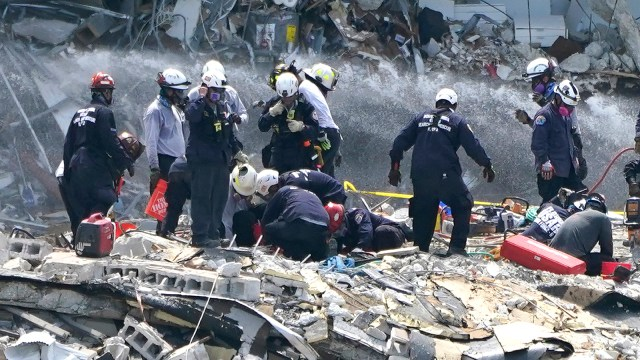 Rescue workers search the rubble of the Champlain Towers South condominium, Saturday, June 26, in the Surfside area of Miami.