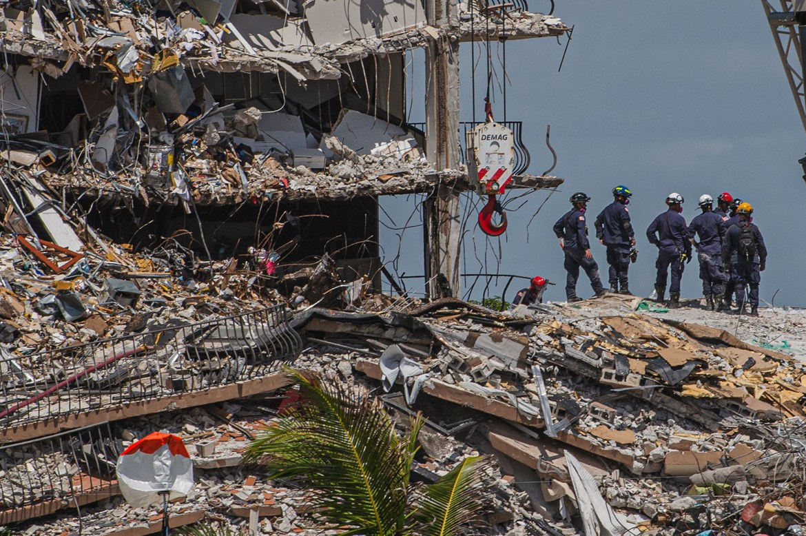 Search and Rescue teams look for possible survivors in the partially collapsed 12-story Champlain Towers South condo building on June 27, in Surfside, Florida.
