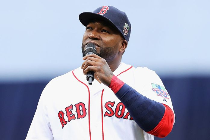 David Ortiz addresses the crowd during the pregame ceremony to honor his retirement before his last regular season home game at Fenway Park on October 2, 2016 in Boston.