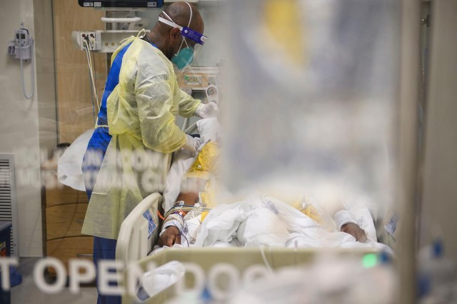 A nurse attends to a patient in a Covid-19 ICU at Martin Luther King Jr. Community Hospital on January 6 in the Willowbrook neighborhood of Los Angeles.