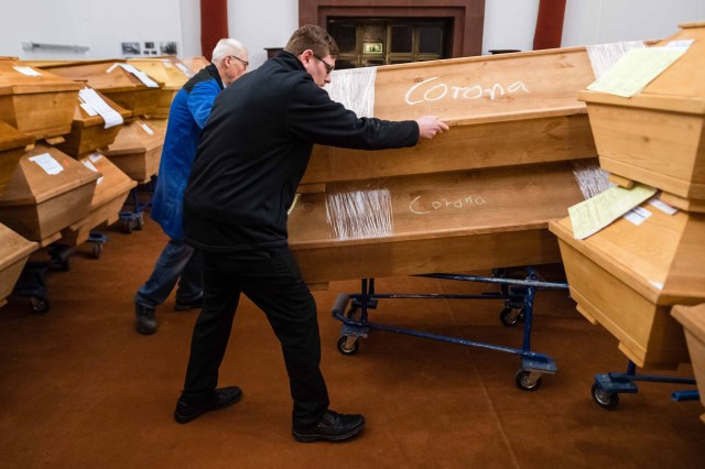 Employees move coffins at a crematorium in Meissen, Germany on January 13.