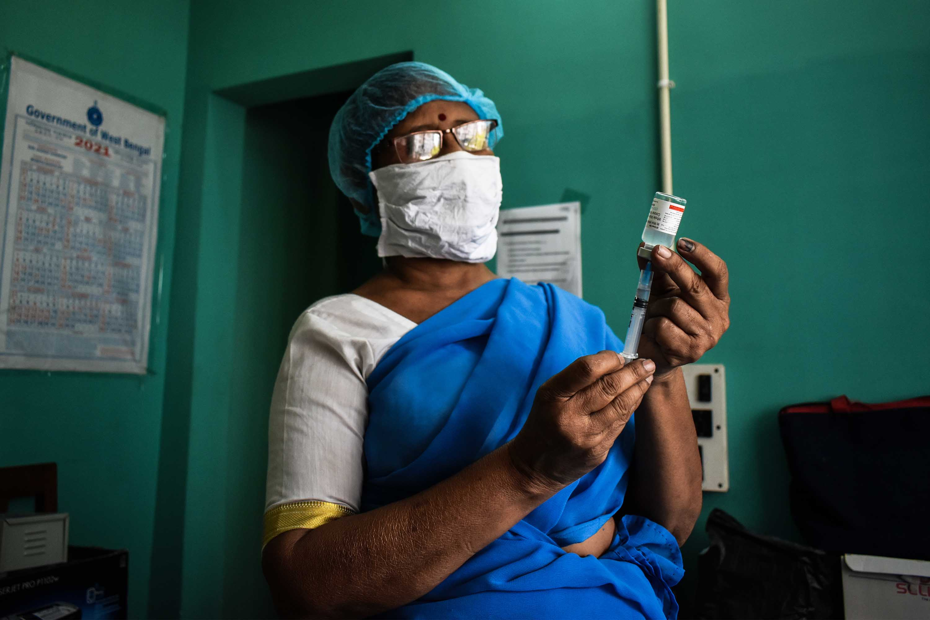 A health worker prepares a dose of the Covaxin vaccine at a vaccination center in Kolkata, India, on April 24.