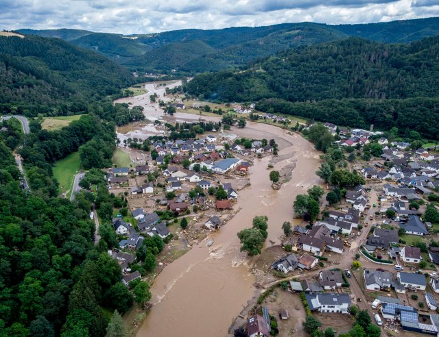 The Ahr river floats past destroyed houses in Insul, Germany, on Thursday.