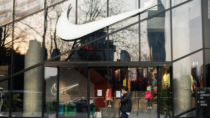 A pedestrian walking through a Nike store in Shanghai in March.