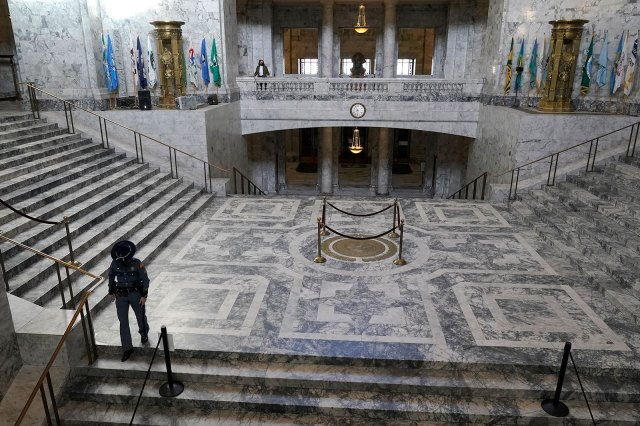 A Washington State Patrol trooper walks through the rotunda of the state capitol in Olympia on Wednesday, January 13.