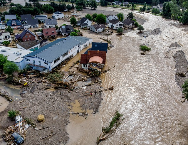 Damaged houses are seen at the Ahr river in Insul, western Germany on Thursday, July 15.