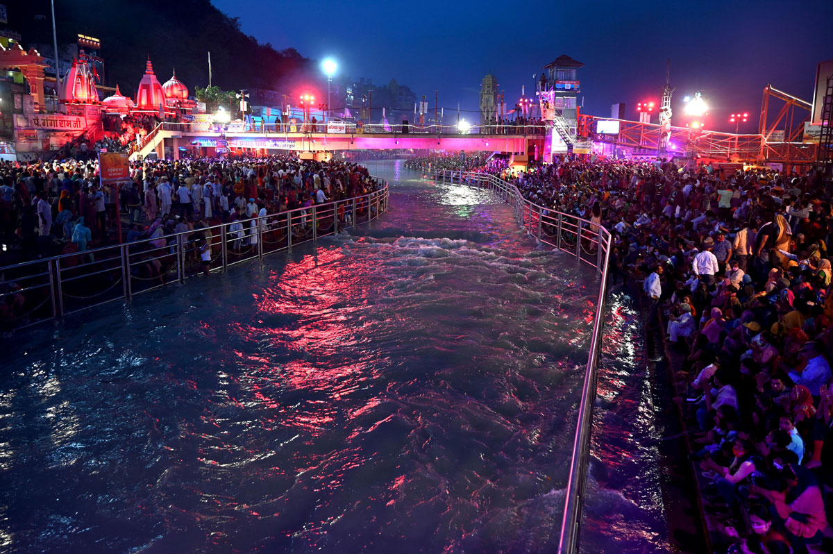 Hindu devotees gather on the banks of Ganges River during the Kumbh Mela festival in Haridwar on April 11.
