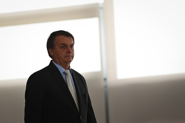 "President of Brazil Jair Bolsonaro arrives for the opening ceremony of the forum ""The Control in Combating Corruption"" at Planalto Palace on December 9, 2020 in Brasilia."