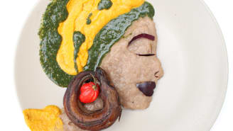 A portrait made with dry fish, pepper, amala (cooked yam flour) and ewedu soup (cooked corchorus leaves).