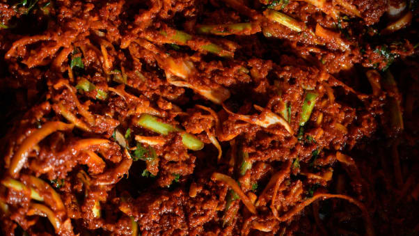 A spicy sauce used to make kimchi is prepared during a traditional process known as 'kimjang', at a home in the South Korean port city of Donghae in 2020.