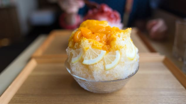 Mixed citrus syrup is poured over shaved ice in this Japanese kakigori.