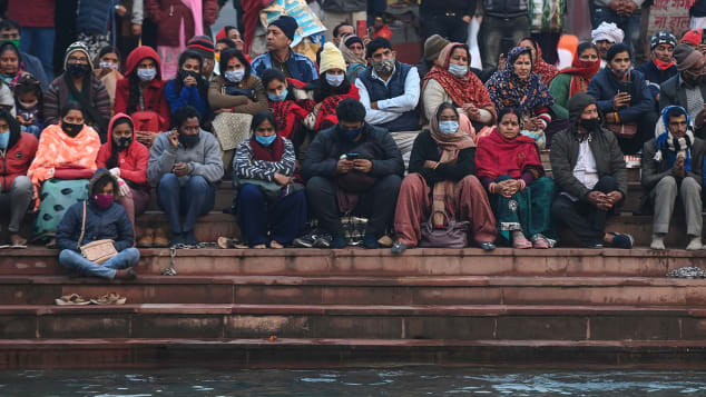 Hindu devotees attend evening prayers on the banks of the River Ganges on January 13.