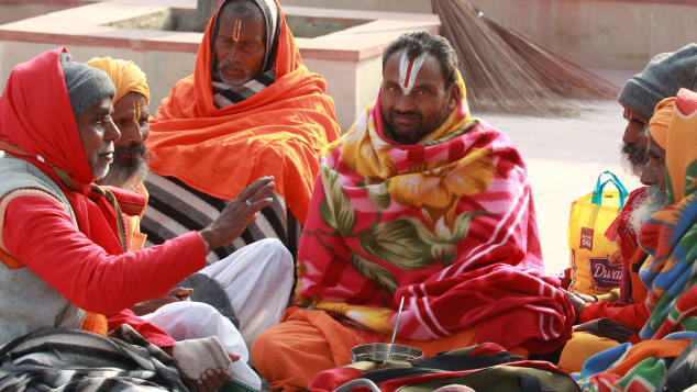 Indian Hindu devotees sit on the banks of the River Ganges in Haridwar on January 14.