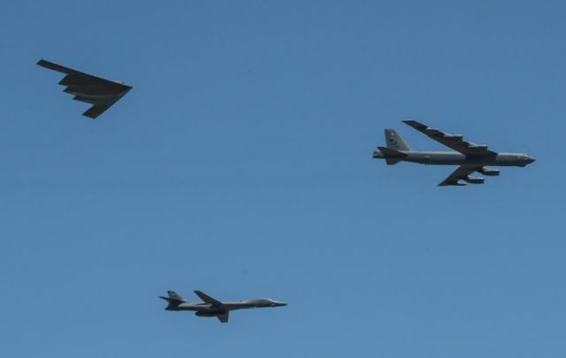 A B-1 Lancer, a B-2 Spirit and a B-52 Stratofortress perform a flyover at Barksdale Air Force Base.