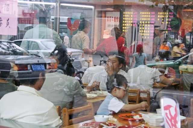 The first image in Stünkel's series was taken in a restaurant window in Shanghai.
