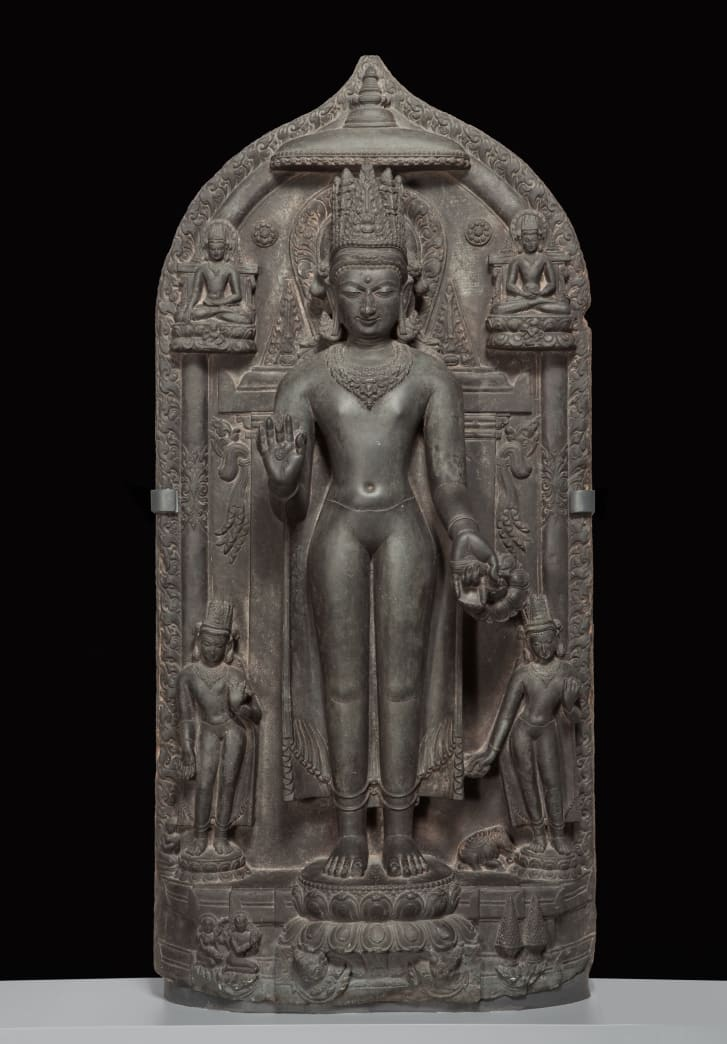 "A basalt statue: ""Standing crowned Buddha with four scenes of his life,"" approx. 1050--1100. southern Magadha region, Bihar state, India. Part of the Brundage Collection at the Asian Art Museum, San Francisco."